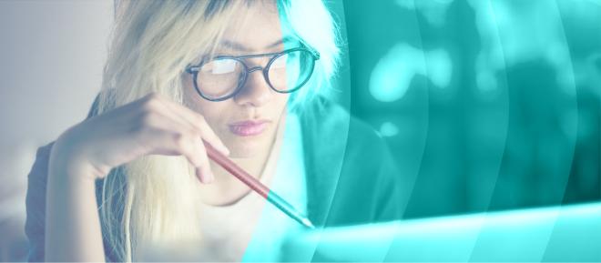 Woman sitting at laptop